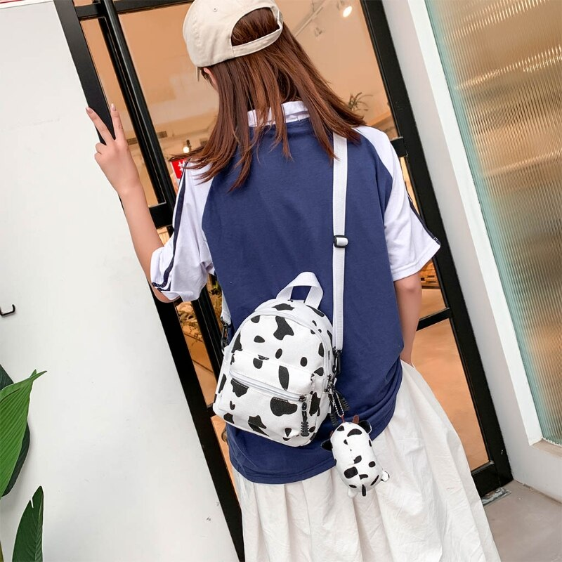 Mini Canvas Daypack with Plush Pendant Cow Print Backpack for Women Lady Girls